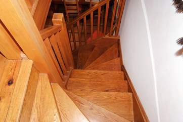The wooden staircase leads to the master bedroom and bathroom.