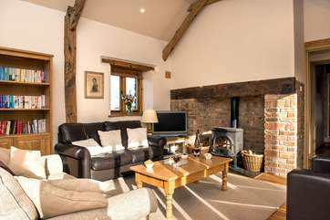 The sitting room is charming with oak flooring and large comfy sofas