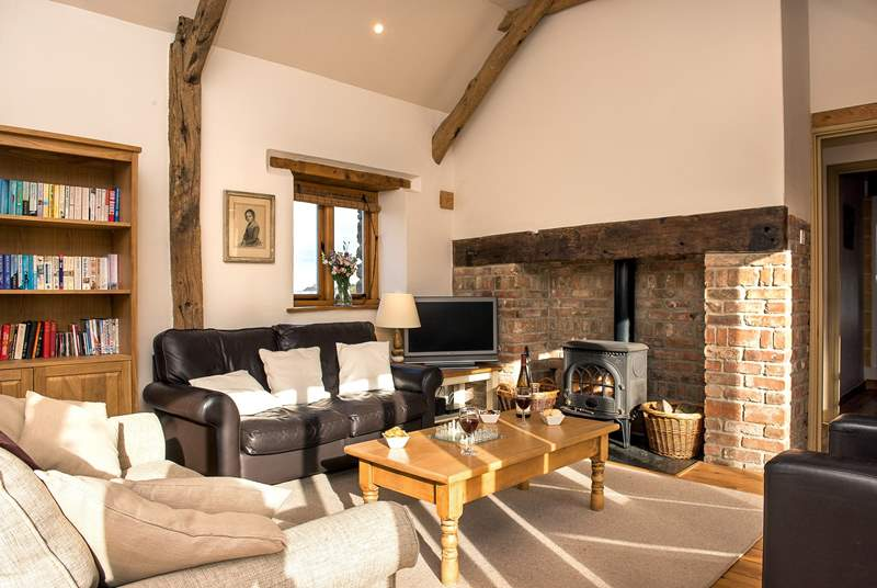 The sitting-room is charming with oak flooring and large comfy sofas.