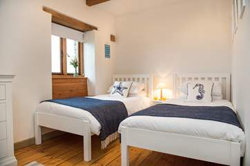 The twin bedded room has lovely crisp white linen and gentle reminders that you are so close to the sea