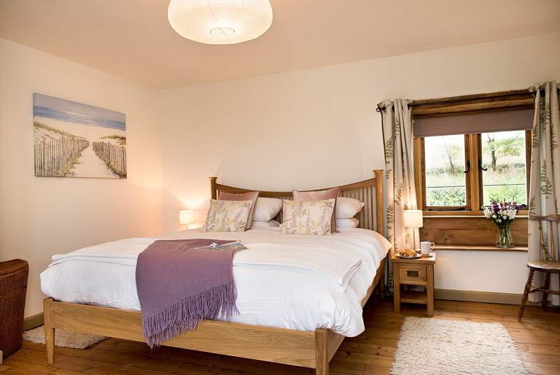The double aspect  master bedroom is very spacious and beautifully furnished.