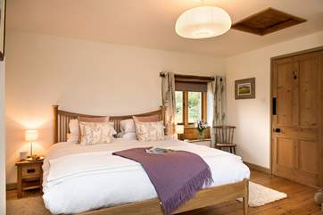 The master bedroom enjoys views over the open countryside out to sea