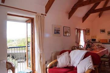 There are French doors on both sides of the living-room with views over farmland on one side and the garden on the other.