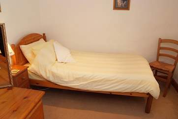All of the bedrooms are comfortably furnished with solid wood furniture.