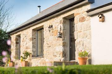 This lovely stone cottage once housed guests of the four legged variety.