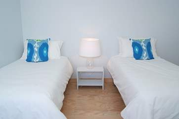 The twin bedroom is light and spacious and simply furnished.