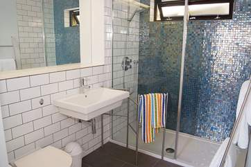 The gorgeous shower-room includes a spacious shower cubicle.