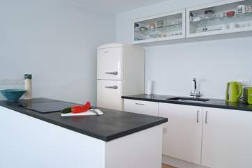 The stylish and well-equipped kitchen includes a Smeg fridge/freezer.