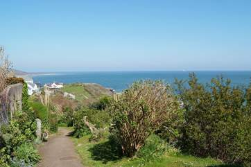The coastal path will also take you into the village in a few short minutes where you will find places to eat, drink and buy some holiday mementos.