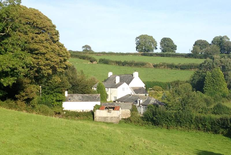 The three cottages and Owner's house seen from the fields opposite.