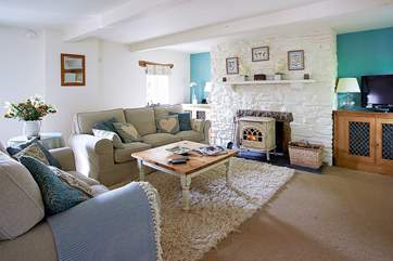 The cosy seating-area around the wood-burner in Medlar Cottage (2595).