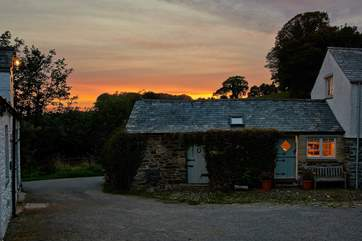 The exteiror of Medlar Cottage (2595) with the sun sinking slowly in the west.