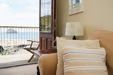 The French doors lead out to the patio where you will have a seagull's view of the beach.