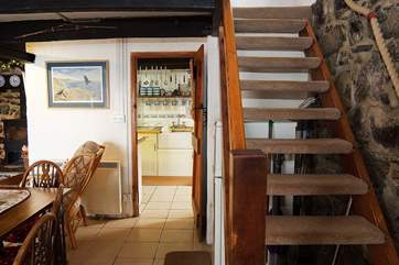 The open-tread stairs are typically steep but the handrail and rope support are there if required.