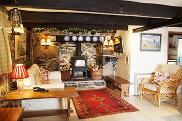 The sitting-room is cosy, comfortable and very welcoming.