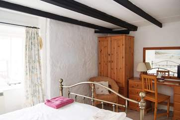 The double room is comfortably furnished.
