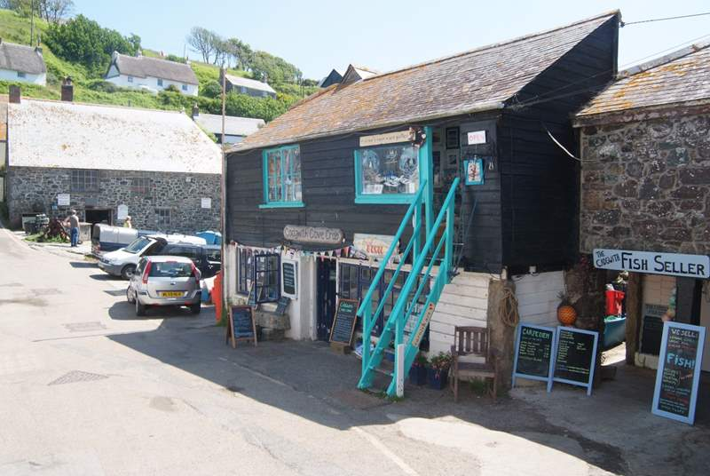 Pretty Cadgwith where you can eat your fish cooked by a chef in the pub or restaurant or do it yourself with catch caught by the local fishermen.