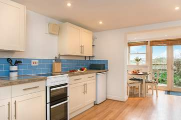 The open plan kitchen dining area is ideal for all the family