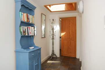 The spacious hallway leads to the utility-room.