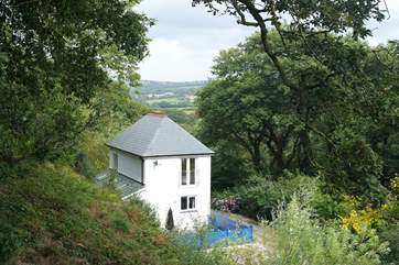 Christmas Cottage is tucked away amid 20 acres of sheltered grounds, overlooking beautiful Bicton Woods and Dartmoor in the far distance.