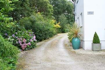 The private driveway passes Christmas Cottage to the parking-area beyond.