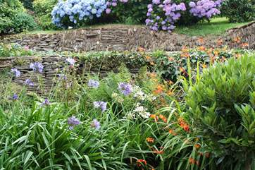 Lovely stone walls enclose the little front garden.