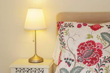 Pretty cushions and lamps in Bedroom 4.