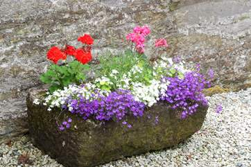 A prettily-planted old stone trough.