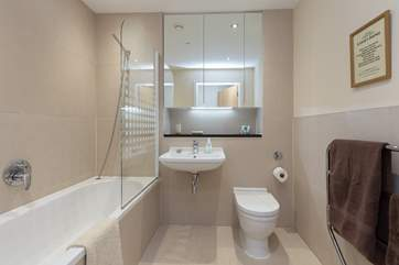 The family bathroom - another lovely room with an extra wide door, bath and fitted shower.