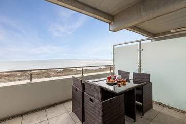 The balcony runs the full width of the apartment and has fabulous open sea views.