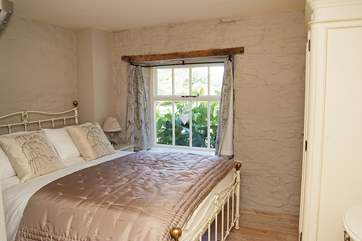 The double bedroom in the mill is beautifully furnished.