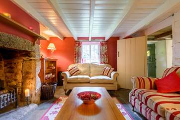 The sitting-room in the cottage side is really cosy and snug.