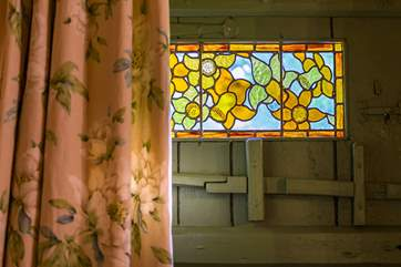 A stained glass panel in the cottage kitchen.