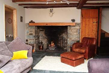 The cosy sitting-room with its warming open fire.