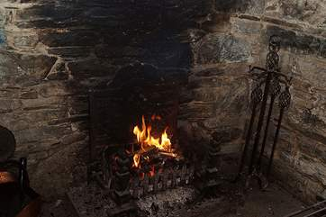 A blazing fire giving warmth on cooler evenings.