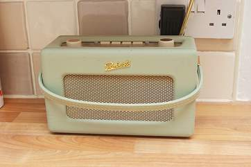 A vintage sytle radio in the kitchen.