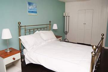 Sparkling white linen is on all the beds. This is bedroom 1.