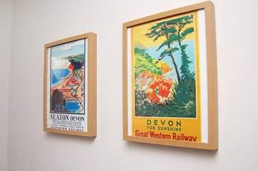 Fifties Devon posters on the landing.