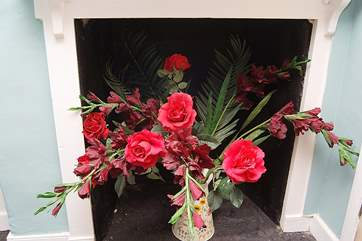Pretty fabric flowers in the ornamental fireplace in bedroom 2.