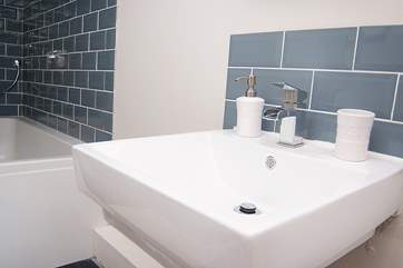 A bright modern bathroom is on the top floor.
