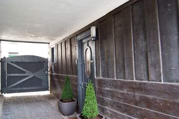 Looking back to the entrance gates into the mews.