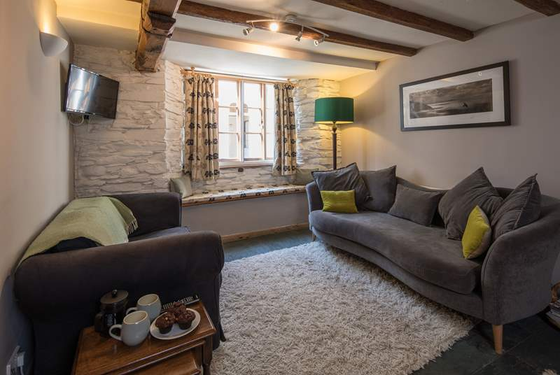 The living-room offers a cosy area to cuddle up after an action-packed day.