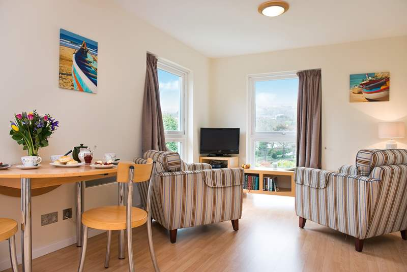 The open plan living-room has two lovely large windows allowing the light to flood in and for you to admire the view.
