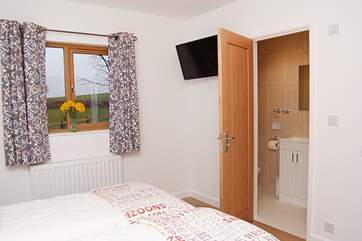 The twin bedroom has an en suite shower-room.