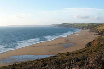 A footpath wends its way down the cliff to wonderful Long Sands below Tregantle Fort.