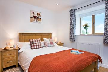 Lovely linens and soft cushions on the bed make the cottage very homely.