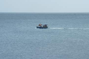 A fishing boat steaming along past Slapton Sands.