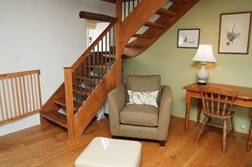 The turned wooden stairs leading up to Bedroom 2.