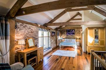 Bedroom 2 is a real treat with its beautiful beams and stunning wooden floors.