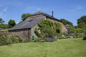 Behind Leigh Barn lies the most lovingly maintained gardens and lawn.